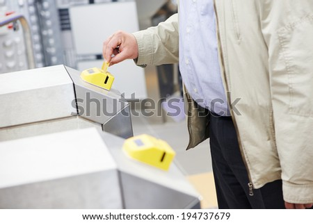 electronic key access system to pass through turnstile - stock photo