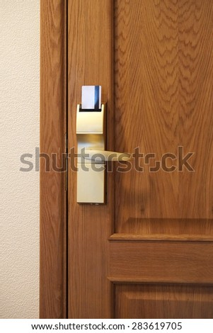 Electronic lock in a hotel - stock photo