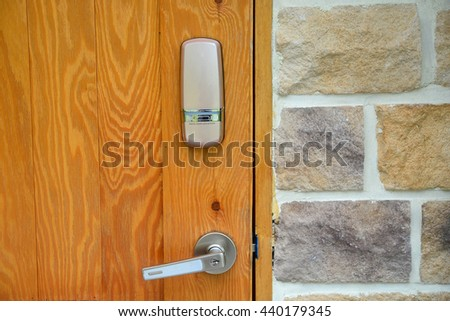 Electronic lock on wooden door  - stock photo