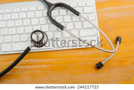 Electronic medical, stethoscope on Keyboard. - stock photo