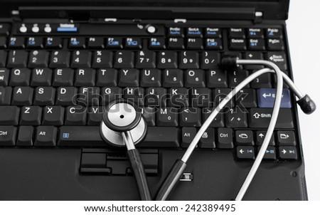 Electronic medical, stethoscope on PC/Laptop/Keyboard - stock photo