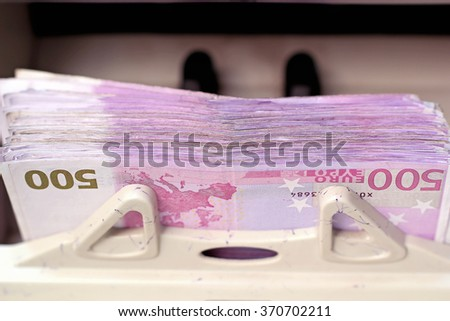 Electronic Money Counter Processing Euro 500 Bills. European Union Currency. Counting Money. Electronic Money Counter with Euro Bills. Business. - stock photo