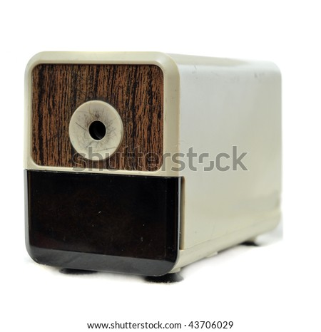 Electronic pencil sharpener isolated on white background with wooden face plate.