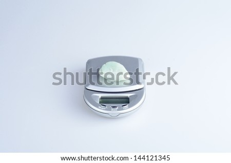 Electronic scale on a white background
