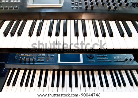 electronic synthesizer with keyboard and knobs closeup - stock photo