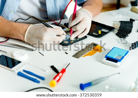 Electronic technician measure electricity - stock photo