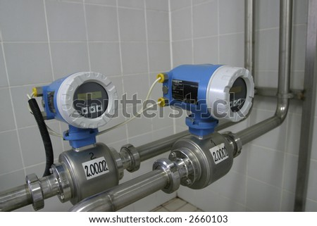 electronic temperature control valves in dairy production factory - stock photo