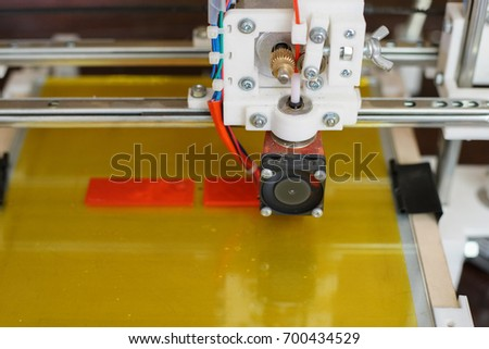 Electronic three dimensional plastic printer during work in school laboratory