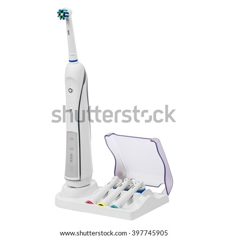 Electronic toothbrush on a stand with replacement brush heads isolated on a white background - stock photo