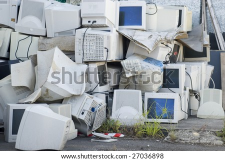 Electronic waste, a large pile of unwanted computer monitors - stock photo