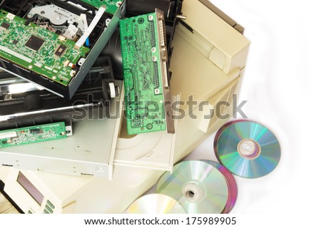 Electronic waste ready for recycling. Old computer parts on white background. - stock photo