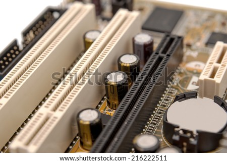 Electronics components on modern PC computer motherboard with PCI connector slot - stock photo