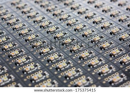 Electronics - LED chips on the black PCB - stock photo