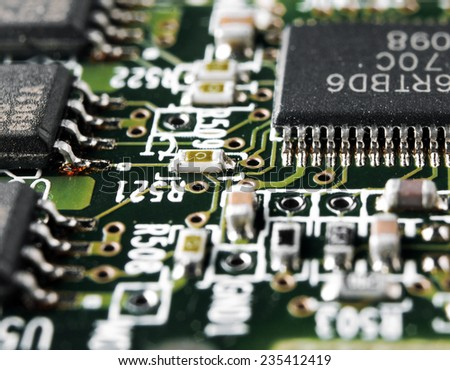 Electronics. Motherboard close up. Semiconductors, nanotechnology and engineering. Grain added - stock photo