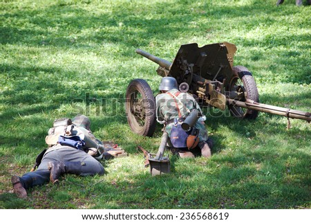 ELECTROUGLI CITY - MAY 9: Cannon squad in action during reenactment of the last battle in WWII on celebration of The Victory day in World War II, in Moscow region, Electrougli city, Russia, 2014 - stock photo
