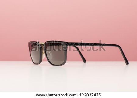 Elegance brown Sunglasses on white background - stock photo