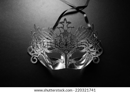Elegance carnival mask on dark background - stock photo