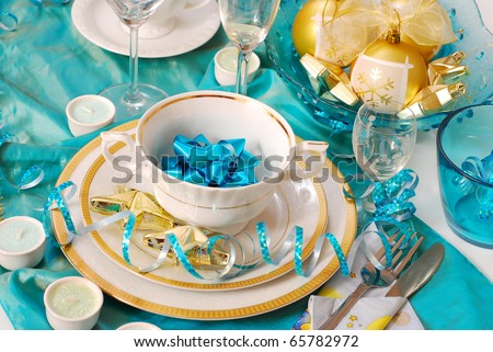 elegance christmas table decoration in turquoise,white and golden colors - stock photo
