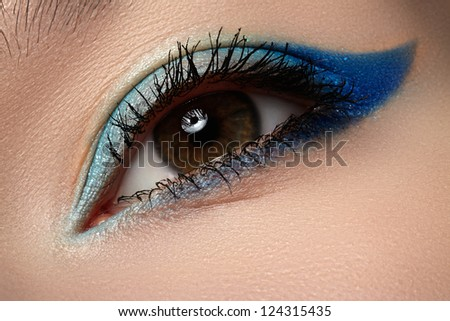 Elegance close-up of beautiful female eye with marine colors eyeshadow. Macro shot of beautiful woman's face part with makeup. Cosmetics, beauty and make-up - stock photo