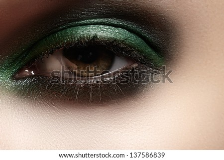 Elegance close-up of female eye with mint color eyeshadow. Macro shot of beautiful woman's face part. Wellness, cosmetics and make-up. - stock photo