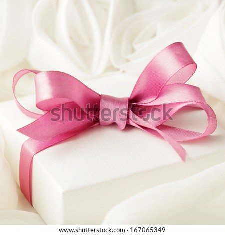 elegance gift with ribbon bow - stock photo