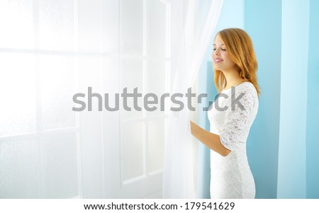 Elegance girl at the window light background - stock photo