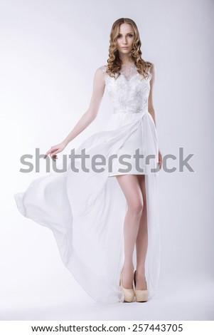 Elegance. Gorgeous Bride in Luxurious Dress - stock photo