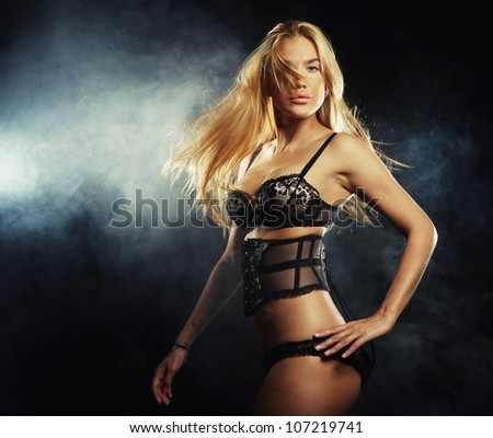elegance lady in the lingerie dancing in the night club - stock photo