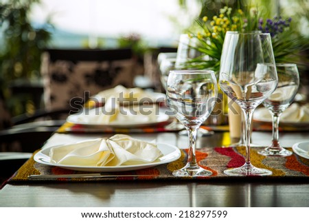 Elegance shot of fine dinning set in hotel restaurant. Vacation and leisure theme. - stock photo