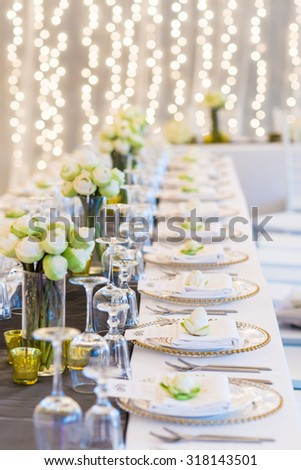 Elegance table set up with lotus flowers, selective focus. (set) - stock photo
