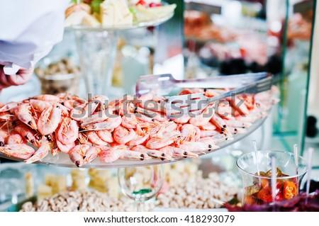 Elegance wedding reception table with food shrimp - stock photo