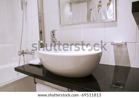 Elegance white washstand and faucet with mirror - stock photo