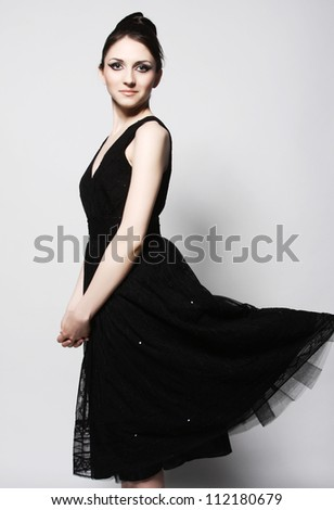 Elegance woman in black dress. Retro style. - stock photo