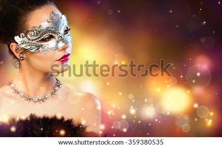 Elegance Woman Wearing Carnival Mask With Golden Stardust  - stock photo