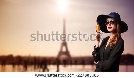 Elegance women with perfume bottle  - stock photo