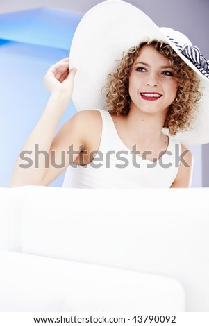 Elegance Young blonde in white summer hat . - stock photo