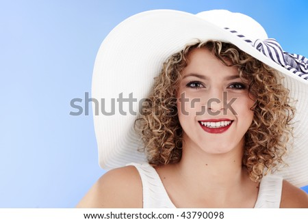 Elegance Young blonde in white summer hat .