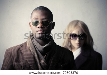 Elegant african man with mannequin on the background - stock photo