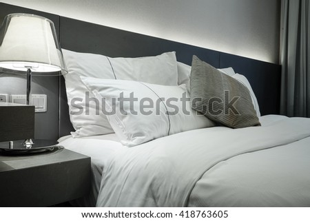 Elegant and comfortable home & hotel bedroom interior. - stock photo