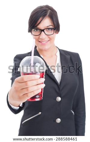 Elegant and friendly woman offering healthy red juice in a cup to go with straw - stock photo