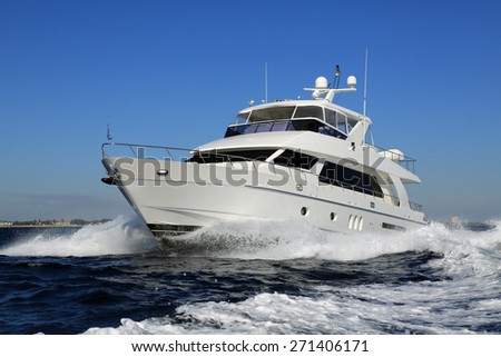 Elegant and graceful luxury power boat underway off Palm Beach, Florida