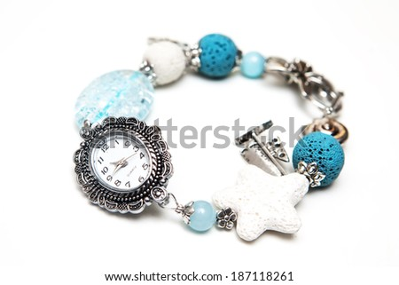 Elegant and modern bracelet made from volcanic lava rock, glass and silver on white background - stock photo