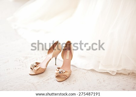 Elegant and stylish bridal shoes. - stock photo