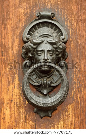 elegant antique door knocker ,Tuscany,  Italy - stock photo