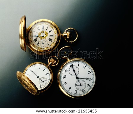 Elegant antique pocket watches on a black background