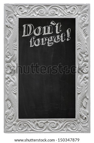Elegant antique white picture frame with chalkboard - blackboard used as Don`t Forget! - isolated on a white background - stock photo