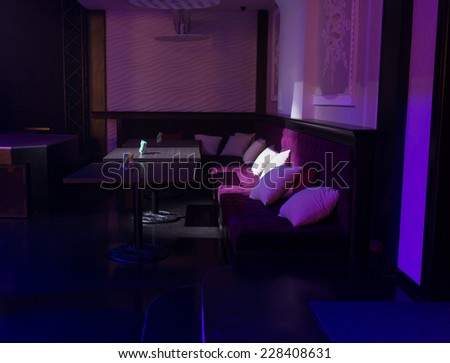 Elegant Architectural Bar Interior Design with Tables and Chairs for Guests in Dim Lighting. - stock photo
