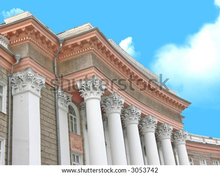 Elegant architectural creation in antique style on a background of the blue sky - stock photo