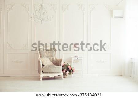 elegant armchair in luxury clean bright white interior - stock photo
