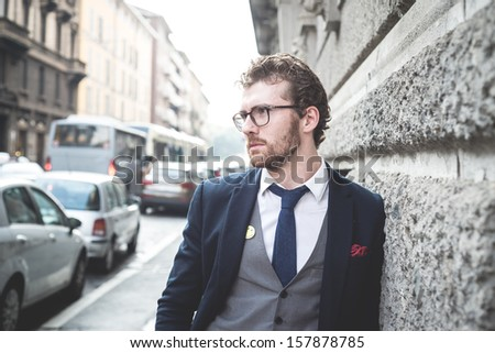 elegant attractive fashion hipster man lifestyle in the city - stock photo